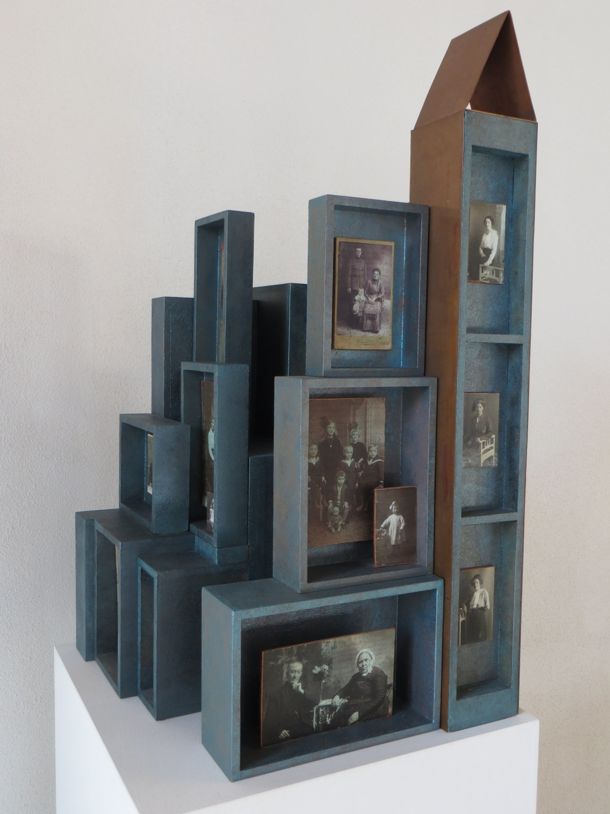 2012<br>40 x 40 x 68 cm<br>photographs, mdf, copper